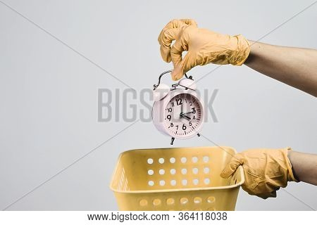 Time To Bin. Hand Throwing Alarm Clock To Rubbish Bin. Health Insurance Problems, Lost Time, Pointle