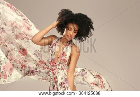 Afro Woman In Floral Maxi Dress.