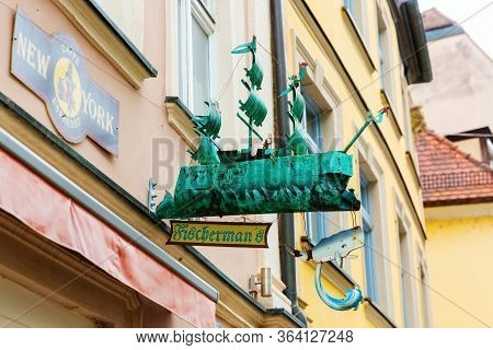 Antique Shop Sign In The Old Town Of Bamberg, Germany