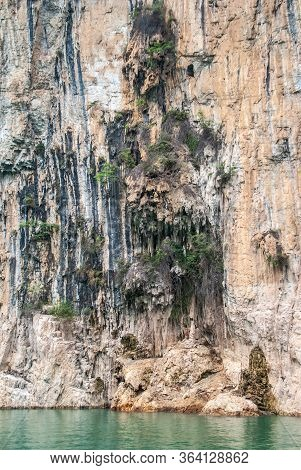 Wuchan, China - May 7, 2010: Dawu Or Misty Gorge On Daning River. Packs Of Stalactites Hang Form Bro
