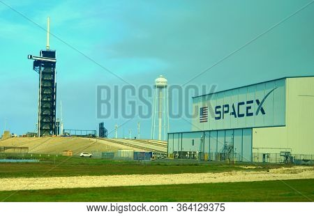 Cape Canaveral, Florida, U.s.a - February 17, 2019 - The View Of The Spacex Building Next To A Rocke