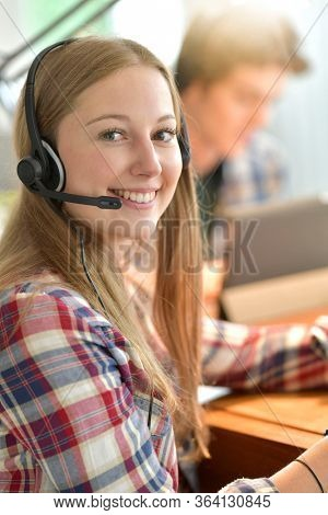 Young woman studying from home during confinement period
