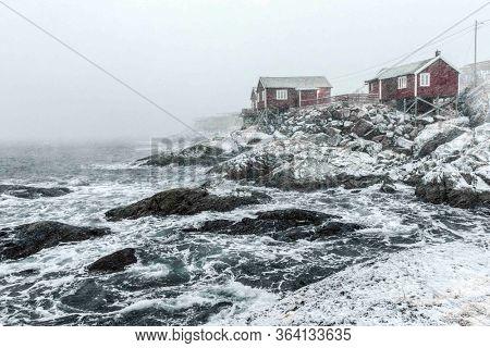 Hamnoy, Norway, fishing village on Lofoten Islands during a snow storm