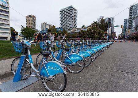 Downtown Vancouver, Bc, Canada - Apr 26, 2020: Mobi Shared Bikes Sit Unused In English Bay Due To Th