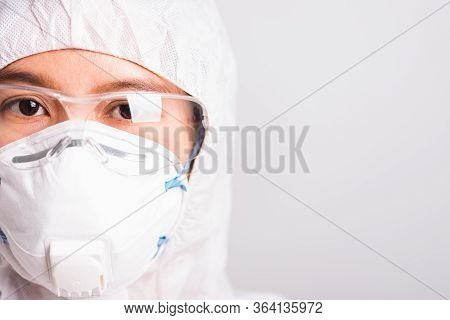 Closeup Face Of Portrait Woman Doctor Or Scientist In Ppe Suite Uniform Wearing Face Mask N95 Protec