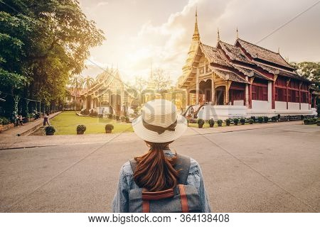 Female Tourist Looking To The Beautiful View Of Wat Phra Singh One Of The Best Examples Of Classic L