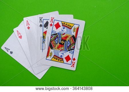 Full House Hand Of Cards On Bright Green Flat Lay In A Game Of Texas Holdem Poker Gambling At A Casi