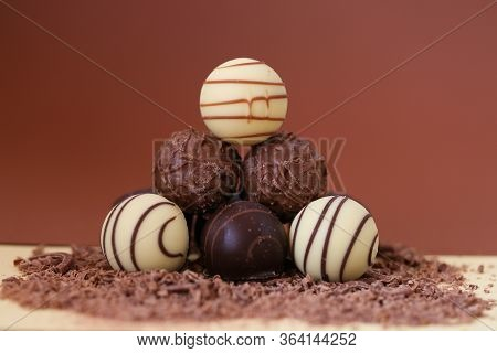 Chocolate Candies Set.white And Black Chocolate Truffles In Grated Chocolate On A Combined Bright Br