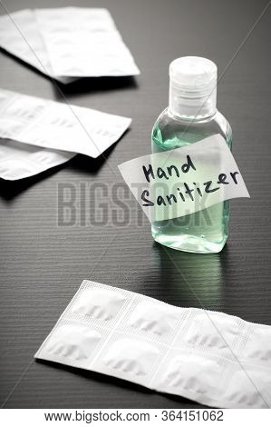 Antibacterial Alcohol-containing Hand Sanitizer In A Plastic Bottle. Hand Sanitizer And White Packag