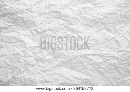 White Crumpled Paper Background. Seamless Paper Texture.