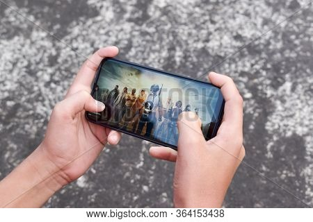 Mobile Game Played On Android Device (feature Phone Or Smart Phone. Cropped Hand Teenage Gamer Boy P