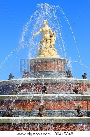 Close up of a beautiful fountain against The Herrenchiemsee Palace inspired by Versailles. Bavaria, Germany.