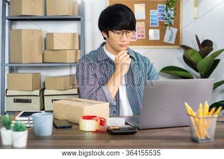 Asian Man Entrepreneur Startup Small Business Entrepreneur Sme Freelance Man Working With Box To Onl