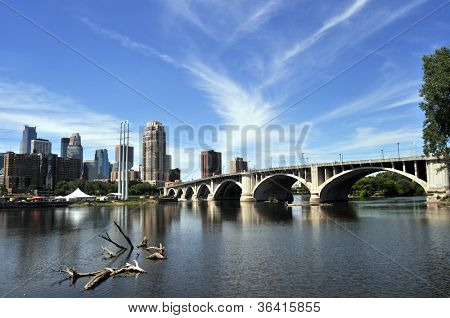 Wide view of downtown Minneapolis at left with Central Avenue (Minnesota 65) Bridge over Mississippi River