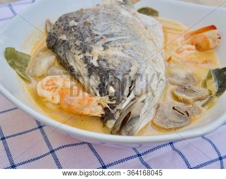 Barramundi Or Asian Sea Bass Fish In The Spicy And Sour Soup, Tom Yum, Thai Food