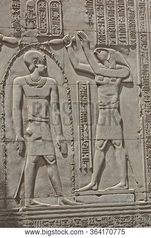 Hieroglypic Carvings On Wall At The Ancient Egyptian Temple Of Kom Ombo With God Horus