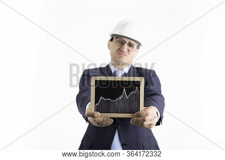 Unhappy Engineer Holding Sign With Rising Chart Of Oil Quotes. Oil Refinery Industry, Heavy Petroche