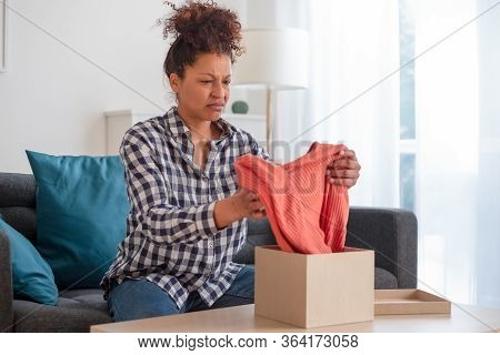 Sad Black Woman Disappointed By Bad Product Purchase