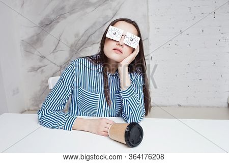 Procrastination And Chronic Fatigue Syndrome In The Workplace. Young Woman Sits At Table And Pretend