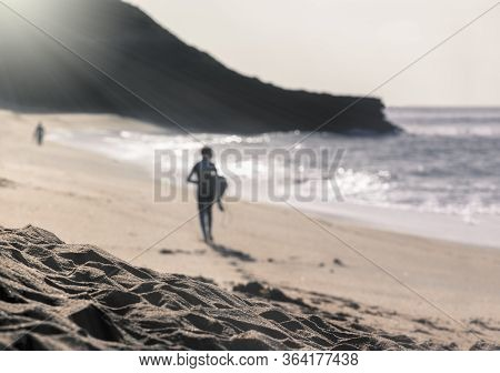 Blurred Image Of Surfer At Bells Beach, Torquay, Australia At A Misty Morning  Getting Ready To Join