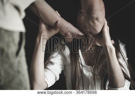 Domestic Violence Concept. Husband Beating And Smothering Wife During Argument. Man Physically Abusi