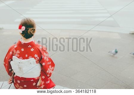 Asian Woman Wearing Traditional Japanese Kimono Relaxing Sitting Under The Tree  Kyoto,experience Ja