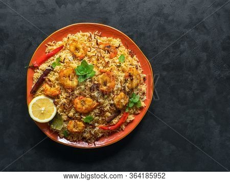Traditional Indian Biryani With Shrimp. Tasty And Delicious Prawns Biryani, Top View, Copy Space.