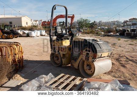 Torrevieja, Valenciana, Spain - May 02 2020 : Small Road Rolle In Builders Yard On Urbanisation In S