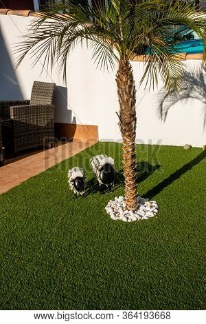 Torrevieja, Valenciana, Spain - May 02 2020 : Model Sheep On Artificial Lawn In Urbanisation In Spai