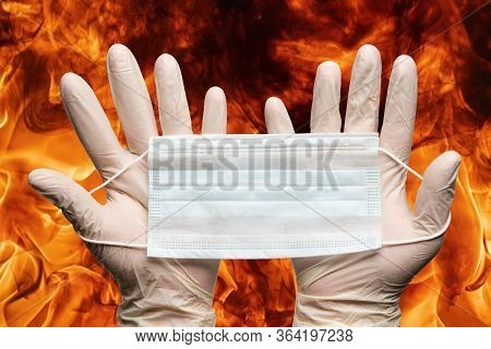 Nurse Hands Holding Respiratory Face Mask In White Medicine Gloves On Background Flames Of Strong Re