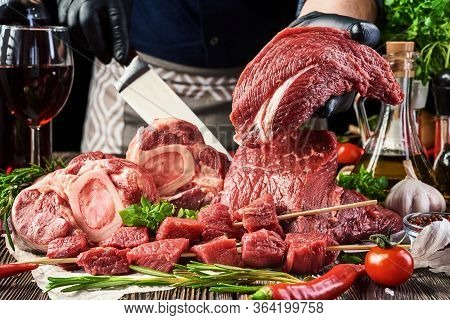 Various Fresh Meat-beef Shank Steak, Veal Tenderloin, Meat Steaks, Meat On Skewers Lie On Parchment