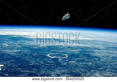 Astronaut In Space, In Zero Gravity Near The Planet Earth. Astronaut In Orbit In Free Flight, Planet