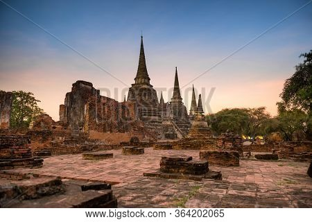 Ruins Of Buddhist Temple Wat Phra Si Sanphet In Ayutthaya At Sunset