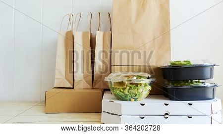 Different Paper Packages And Containers For Takeaway Food On Table. Takeout Meal, Deivery To Home.