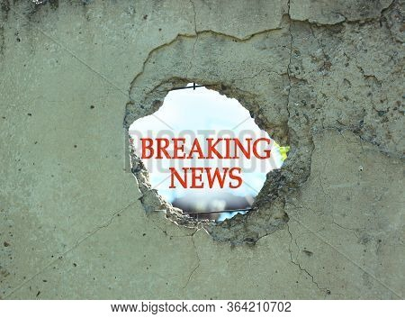 Breaking News Sign In Concrete Fence Hole. Infodemic In Covid-19 Pandemic. True Coronavirus World Up