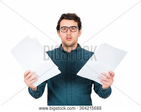 Perplexed Businessman Looking Stunned To Camera As Holds Different Paper Documents In Both Hands Iso