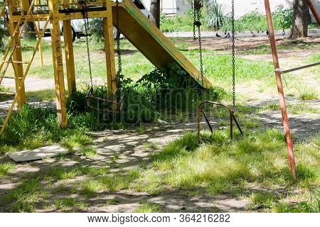 An Empty Playground. Quarantine, Isolation, Empty Playgrounds, Overgrown With Grass, No One, No Chil