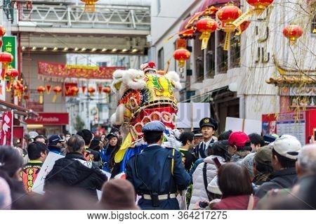 Kobe / Japan - February 17, 2018: Traditional Dragon Dance During Lunar New Year Celebration In Chin