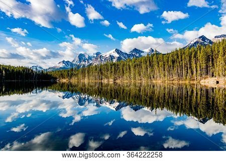 Early Morning Reflections In The Crystal Clear Waters Of Herbert Lake. Banff National Park, Alberta,