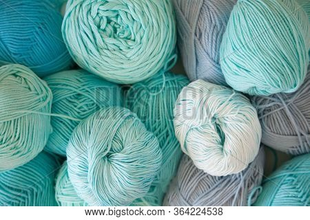 Colored Balls And Skiens Of Yarn. Top View. Aquamarine Colors. Yarn For Knitting.