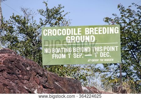 Сrocodile Breeding Ground. The Announcement On The Island In Lake Kariba, Zimbabwe.  Billboard About