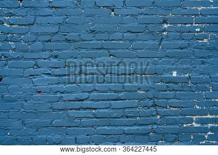 Abstract Blue Background. Blue Paint On A Brick Wall. Texture Of A Blue Brick Wall. The Wall Of The