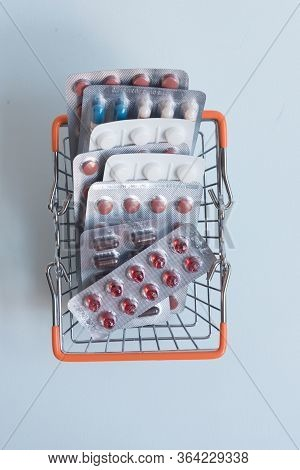 Pharmacy Medicine. Shopping Cart With Pills And Medications. Concept Of Purchasing Medicines.