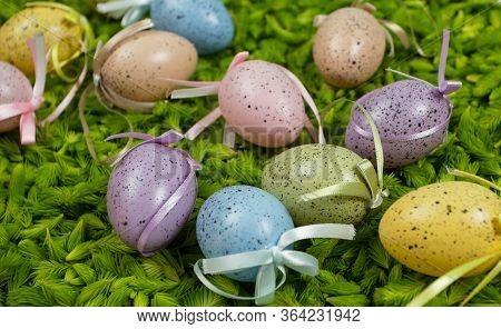 Colorful Easter Eggs On The Fresh Green Background Of Pine Needles