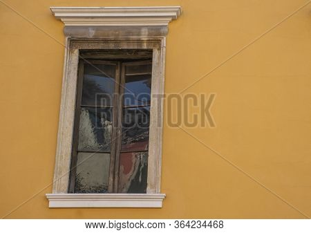Half-open Window With Antique Glass On The Ocher Wall And Marble Jamb