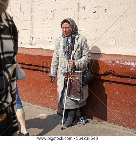 Moscow, Russia - 1st Of May, 2019, A Woman With Sealed Eyes, Pretending To Be Blind, With A Stick In