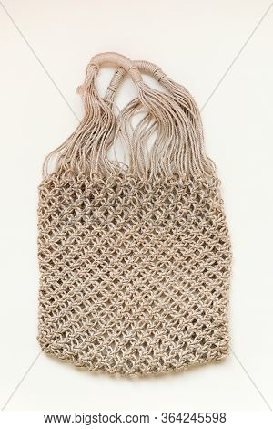 Reusable Net Bag Or Mesh Shopper On Beige Background. Zero Waste, Plastic Free Concept. Eco Friendly