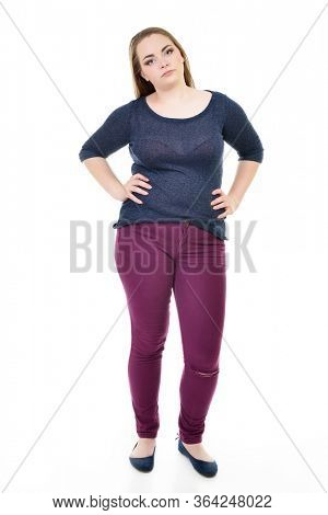 Overweight young woman, over white background. Diet, fitness, excess weight, growing thin, sedentary life, balanced nutrition, overeating, cellulitis, problem of overweight concept.