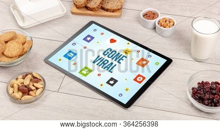 Healthy Tablet Pc compostion with GONE VIRAL inscription, Social networking concept