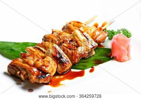 Charcoal Grilled Chicken Yakitori With Tare Sauce. Japanese Food Style In White Background